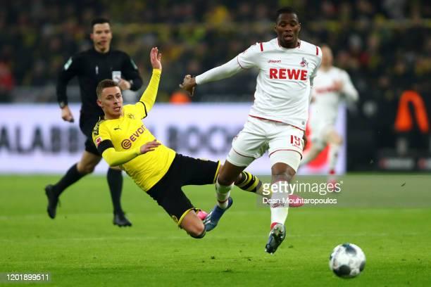 Thorgan Hazard of Borussia Dortmund battles for the ball with Kingsley Ehizibue of FC Koln during the Bundesliga match between Borussia Dortmund and...