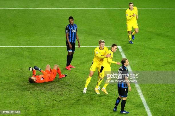 Thorgan Hazard of Borussia Dortmund celebrates scoring his teams first goal of the game with team mate Thorgan Hazard and Thomas Meunier during the...