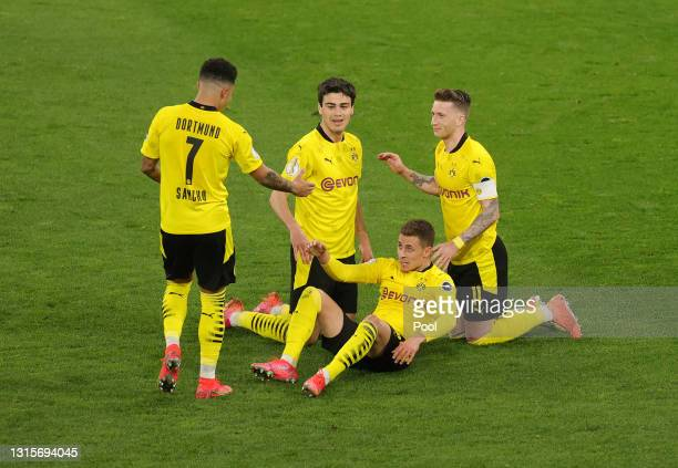 Thorgan Hazard of Borussia Dortmund celebrates with team mates after scoring their side's fourth goal during the DFB Cup semi final match between...