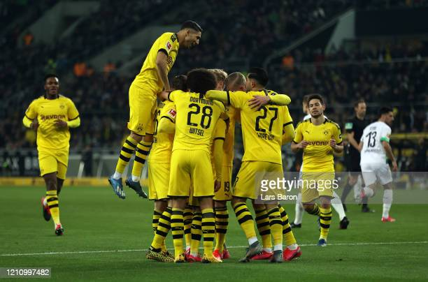 Thorgan Hazard of Borussia Dortmund celebrates with teammates after scoring his team's first goal during the Bundesliga match between Borussia...