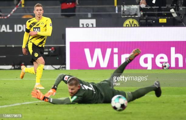 Thorgan Hazard of Borussia Dortmund scores his team's first goal past Timo Horn of 1. FC Koeln during the Bundesliga match between Borussia Dortmund...