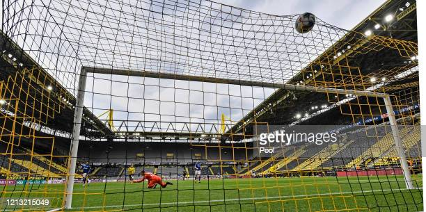 Thorgan Hazard of Borussia Dortmund scores his team's third goal against Markus Schubert of FC Schalke 04 during the Bundesliga match between...