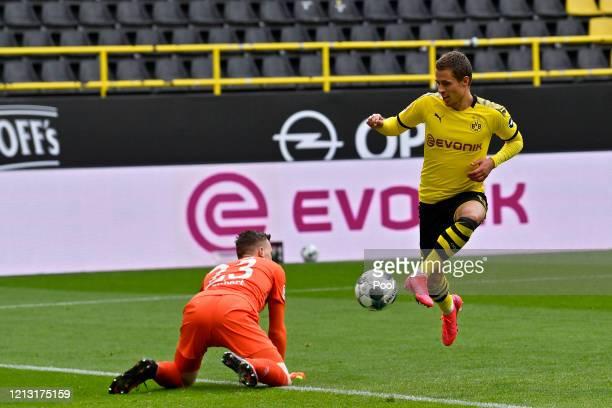 Thorgan Hazard of Borussia Dortmund shoots and scores his team's third goal during the Bundesliga match between Borussia Dortmund and FC Schalke 04...
