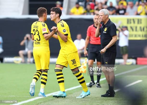 Thorgan Hazard of Borussia Dortmund substitutes Giovanni Reyna of Borussia Dortmund during the preseason friendly match between Udinese Calcio and...