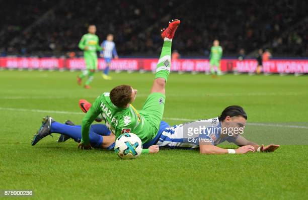 Thorgan Hazard of Borussia Moenchengladbach and Karim Rekik of Hertha BSC during the game between Hertha BSC and Borussia Moecnhengladbach on...