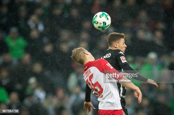 Thorgan Hazard of Borussia Moenchengladbach and Martin Hinteregger of FC Augsburg battle for the ball during the Bundesliga match between Borussia...