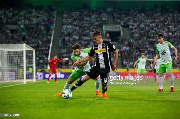 Thorgan Hazard of Borussia Moenchengladbach and Renato Steffen of VfL Wolfsburg battle for the ball during the Bundesliga match between Borussia...