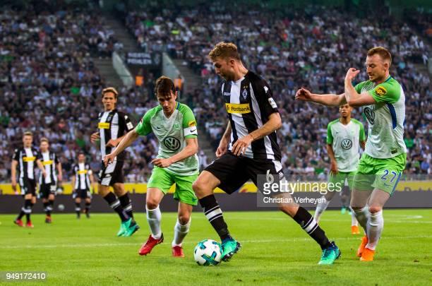 Thorgan Hazard of Borussia Moenchengladbach and Renato Steffen of VfL Wolfsburg and Maximilian Arnold of VfL Wolfsburg battle for the ball during the...