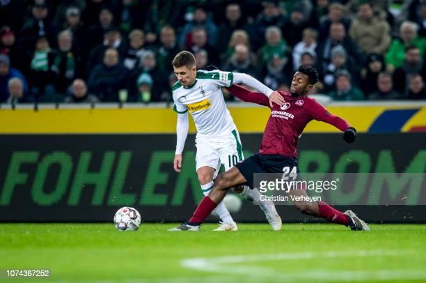 Thorgan Hazard of Borussia Moenchengladbach and Virgil Misidjan of 1FC Nuernberg battle for the ball during the Bundesliga match between Borussia...