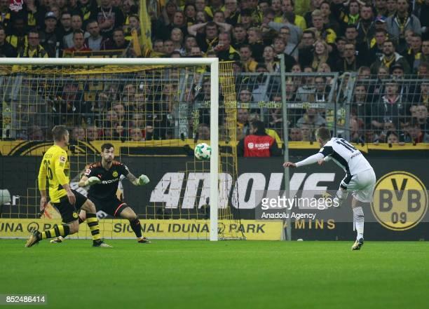 Thorgan Hazard of Borussia Moenchengladbach attempts to score a goal against Goalkeeper Roman Buerki of Borussia Dortmund during the Bundesliga...
