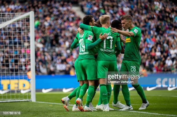 Thorgan Hazard of Borussia Moenchengladbach celebrate with his team mates after he scores his teams first goal during the Bundesliga match between...