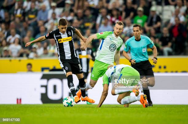 Thorgan Hazard of Borussia Moenchengladbach Maximilian Arnold of VfL Wolfsburg and John Anthony Brooks of VfL Wolfsburg battle for the ball during...