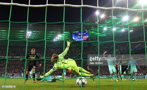 Thorgan Hazard of Borussia Moenchengladbach scores the opening goal past MarcAndre ter Stegen of Barcelona during the UEFA Champions League group C...