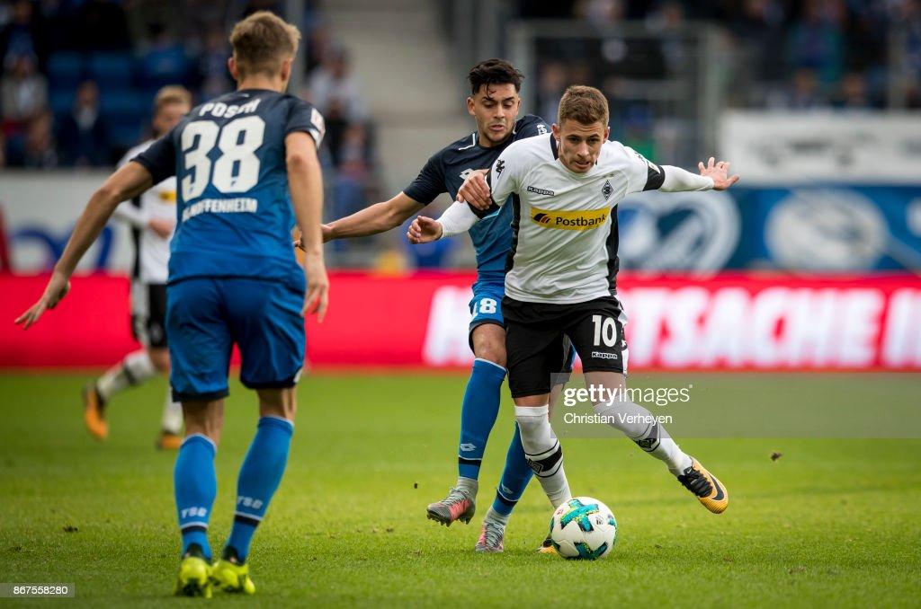 Thorgan Hazard of Borussia Moenchengladbachis chased by Nadiem Amiri of 1899 Hoffenheim during the Bundesliga match between TSG1899 Hoffenheim and Borussia Moenchengladbach at Wirsol Rhein-Neckar-Arena on October 28, 2017 in Sinsheim, Germany.