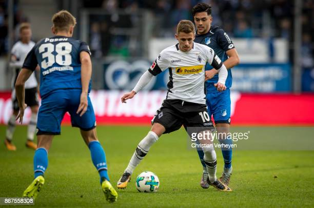 Thorgan Hazard of Borussia Moenchengladbachis chased by Nadiem Amiri of 1899 Hoffenheim during the Bundesliga match between TSG1899 Hoffenheim and...