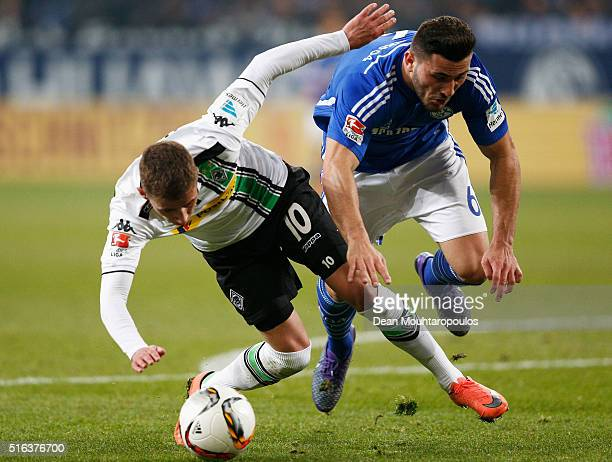 Thorgan Hazard of Borussia Monchengladbach can not get past the tackle from Sead Kolasinac of Schalke during the Bundesliga match between FC Schalke...