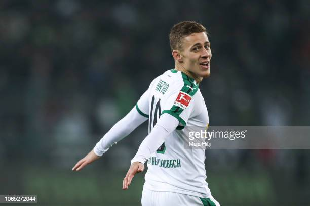 Thorgan Hazard of Borussia Monchengladbach celebrates after scoring his team's first goal during an interview prior to the Bundesliga match between...