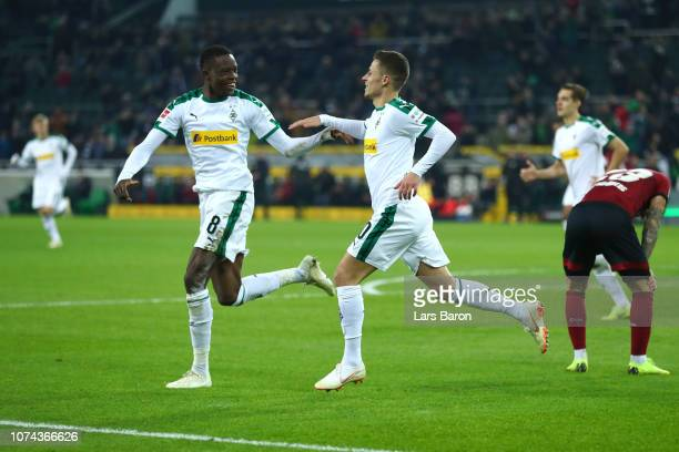 Thorgan Hazard of Borussia Monchengladbach celebrates with Denis Zakaria after he scores his sides first goal during the Bundesliga match between...