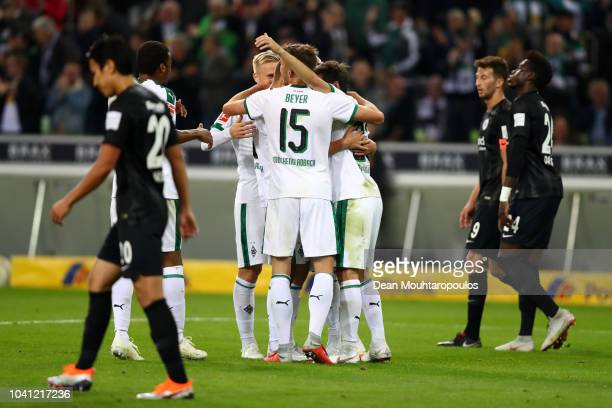 Thorgan Hazard of Borussia Monchengladbach celebrates with team mates after scoring his team's second goal during the Bundesliga match between...
