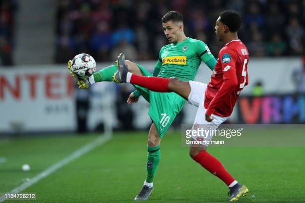 Thorgan Hazard of Borussia Monchengladbach is challenged by Jean-Paul Boetius of FSV Mainz during the Bundesliga match between 1. FSV Mainz 05 and...