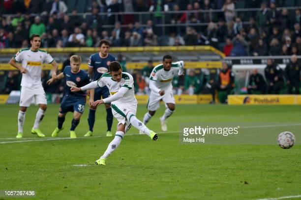 Thorgan Hazard of Borussia Monchengladbach scores a penalty for his team's first goal during the Bundesliga match between Borussia Moenchengladbach...