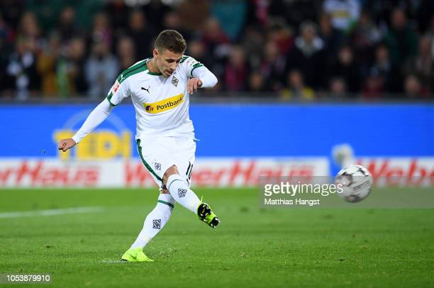 Thorgan Hazard of Borussia Monchengladbach scores his side's first goal from the penalty spot during the Bundesliga match between SportClub Freiburg...
