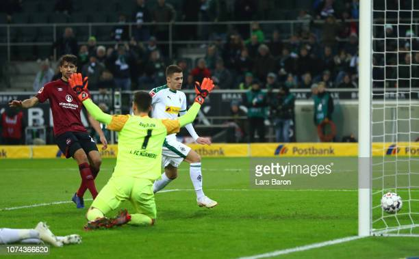 Thorgan Hazard of Borussia Monchengladbach scores his sides first goal during the Bundesliga match between Borussia Moenchengladbach and 1 FC...