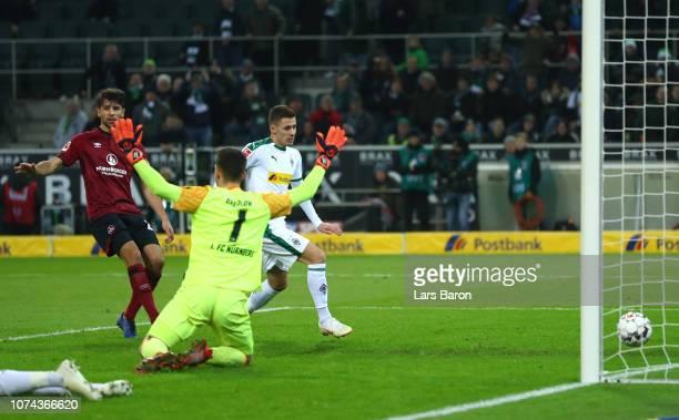 Thorgan Hazard of Borussia Monchengladbach scores his sides first goal during the Bundesliga match between Borussia Moenchengladbach and 1. FC...