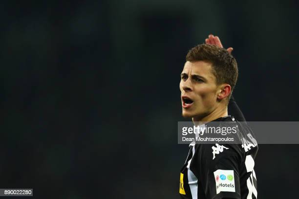 Thorgan Hazard of Borussia Monchengladbach speaks to a team mate during the Bundesliga match between Borussia Moenchengladbach and FC Schalke 04 at...