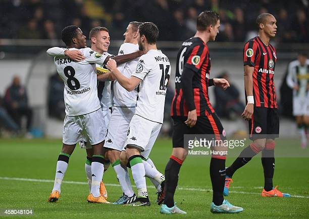 Thorgan Hazard of Gladbach celebrates with his teammates after scoring his team's first goal during during the DFB cup second round match between...