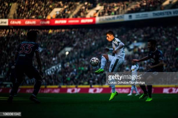 Thorgan Hazard of Mönchengladbach is lit by the sun during the Bundesliga match between Borussia Mönchengladbach and Fortuna Düsseldorf at...