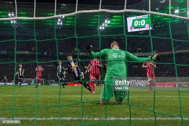 Thorgan Hazard of Moenchengladbach about to take a penally past goalkeeper Sven Ulreich of Bayern Muenchen that results in a goal to make it 10...