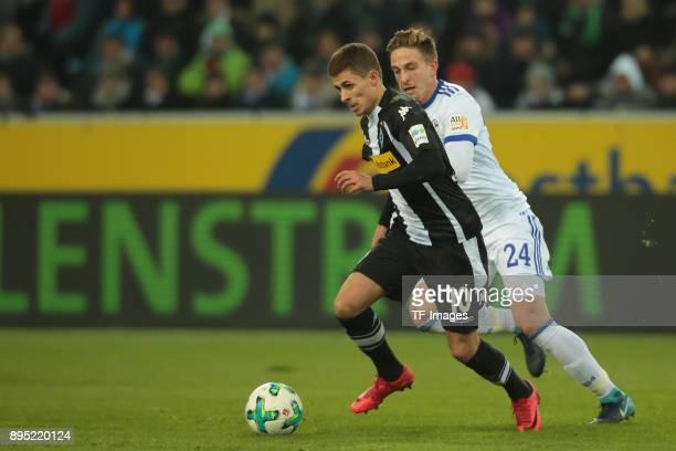Thorgan Hazard of Moenchengladbach and Bastian Oczipka of Schalke battle for the ball during the Bundesliga match between Borussia Moenchengladbach...
