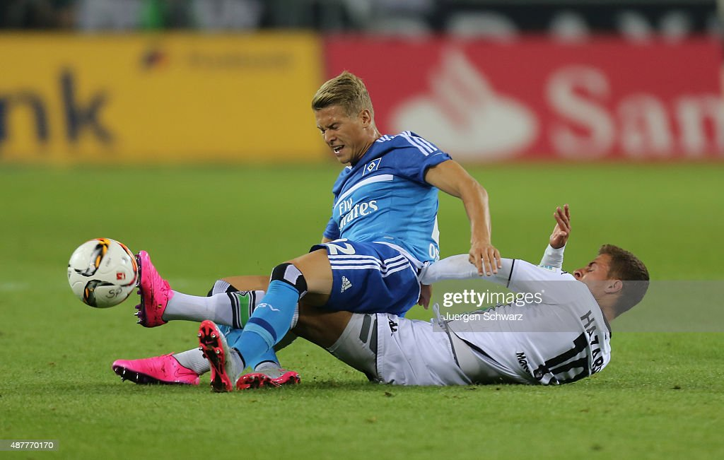 Thorgan Hazard of Moenchengladbach (R) and Matthias Ostrzolek of Hamburg battle for the ball during the Bundesliga match between Borussia Moenchengladbach and Hamburger SV at Borussia-Park on September 11, 2015 in Moenchengladbach, Germany.