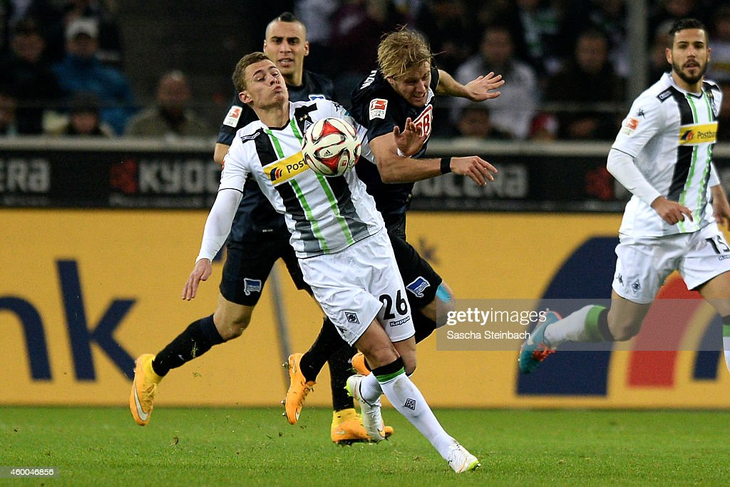 Thorgan Hazard of Moenchengladbach battles for the ball with Per Skjelbred of Berlin during the Bundesliga match between Borussia Moenchengladbach and Hertha BSC Berlin at Borussia Park Stadium on December 6, 2014 in Moenchengladbach, Germany.