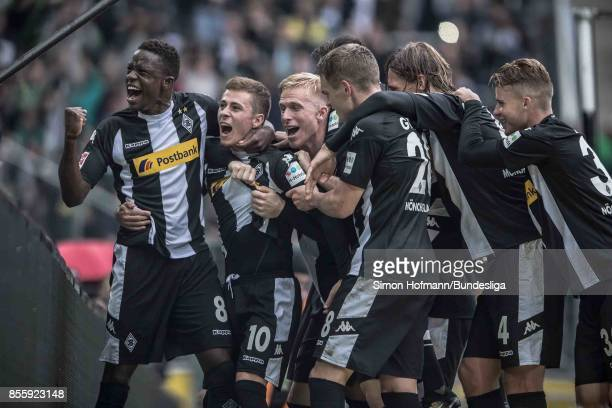 Thorgan Hazard of Moenchengladbach celebrates his team's second goal with team mates during the Bundesliga match between Borussia Moenchengladbach...