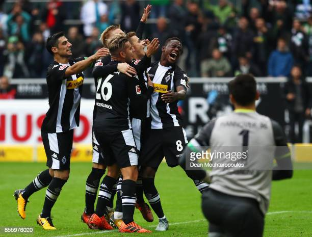 Thorgan Hazard of Moenchengladbach celebrates with his team after he scored the late winning goal form the penalty spot during the Bundesliga match...