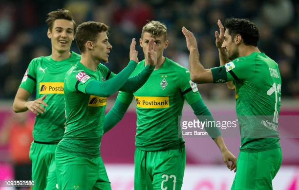 Thorgan Hazard of Moenchengladbach celebrates with Lars Stindl of Moenchengladbach after scoring his teams first goal during the Telekom Cup...
