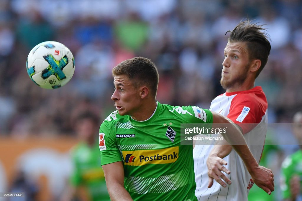 Thorgan Hazard of Moenchengladbach (l) fights for the ball with Jeffrey Gouweleeuw of Augsburg during the Bundesliga match between FC Augsburg and Borussia Moenchengladbach at WWK-Arena on August 26, 2017 in Augsburg, Germany.