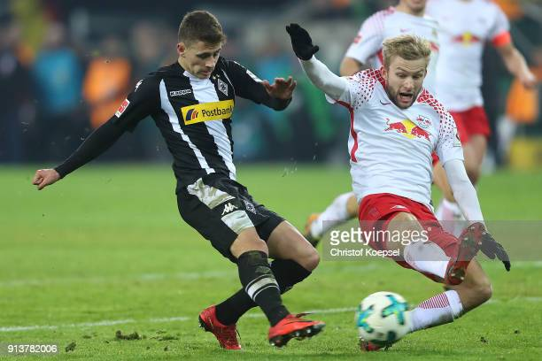 Thorgan Hazard of Moenchengladbach fights for the ball with Konrad Laimer of Leipzig during the Bundesliga match between Borussia Moenchengladbach...