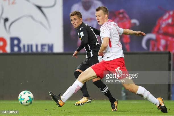 Thorgan Hazard of Moenchengladbach fights for the ball with Lukas Klostermann of Leipzig during the Bundesliga match between RB Leipzig and Borussia...