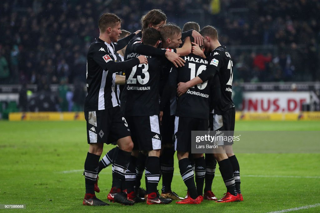 Thorgan Hazard of Moenchengladbach (10) is celebrated by his team after he scored to make it 2:0 during the Bundesliga match between Borussia Moenchengladbach and FC Augsburg at Borussia-Park on January 20, 2018 in Moenchengladbach, Germany. (Photo by Lars Baron/Bongarts/Getty Images)i