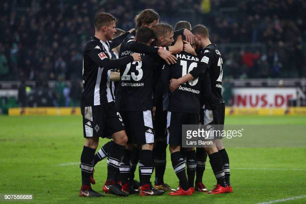 Thorgan Hazard of Moenchengladbach is celebrated by his team after he scored to make it 20 during the Bundesliga match between Borussia...