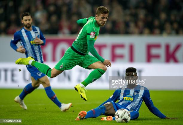 Thorgan Hazard of Moenchengladbach is challenged by Jordan Torunarigha of Berlin during the Telekom Cup Semifinal match between Borussia...