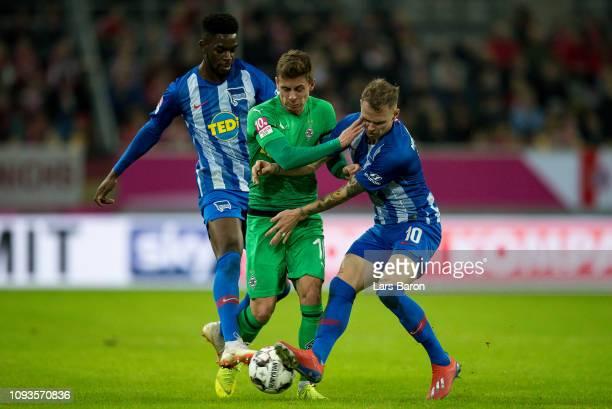 Thorgan Hazard of Moenchengladbach is challenged by Jordan Torunarigha of Berlin and Ondrej Duda of Berlin during the Telekom Cup Semifinal match...