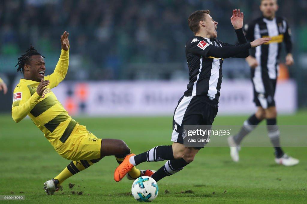 Thorgan Hazard (R) of Moenchengladbach is challenged by Michy Batshuayi of Dortmund during the Bundesliga match between Borussia Moenchengladbach and Borussia Dortmund at Borussia-Park on February 18, 2018 in Moenchengladbach, Germany.