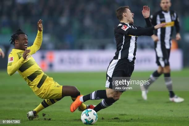 Thorgan Hazard of Moenchengladbach is challenged by Michy Batshuayi of Dortmund during the Bundesliga match between Borussia Moenchengladbach and...