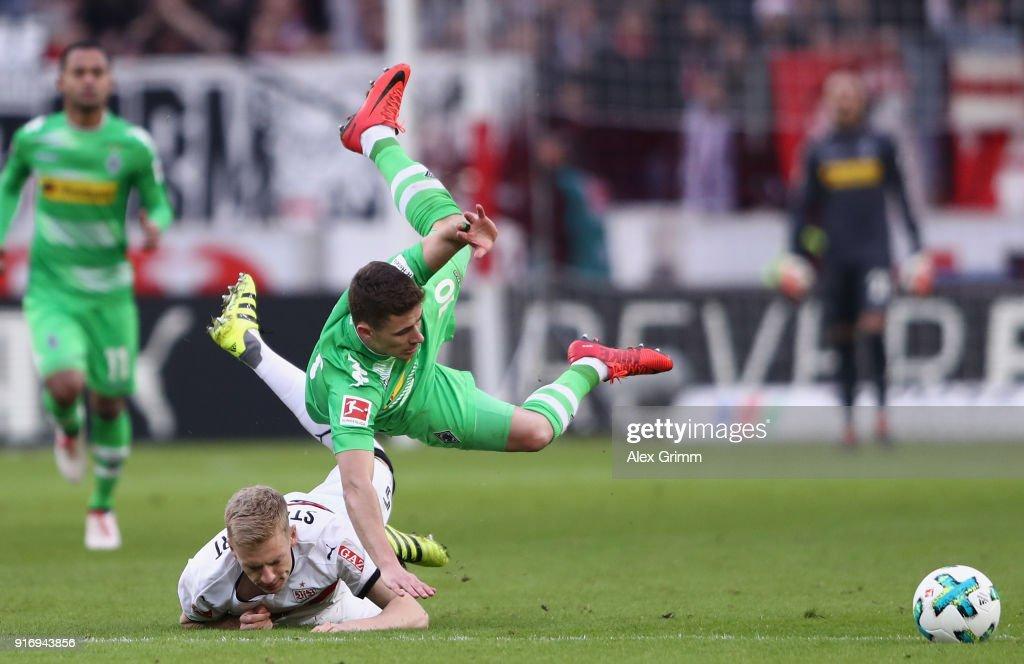 Thorgan Hazard of Moenchengladbach is challenged by Timo Baumgartl of Stuttgart during the Bundesliga match between VfB Stuttgart and Borussia Moenchengladbach at Mercedes-Benz Arena on February 11, 2018 in Stuttgart, Germany.