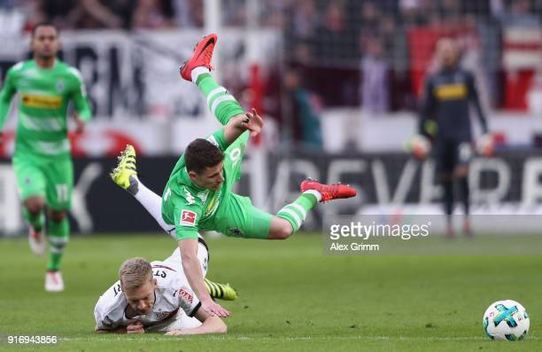 Thorgan Hazard of Moenchengladbach is challenged by Timo Baumgartl of Stuttgart during the Bundesliga match between VfB Stuttgart and Borussia...