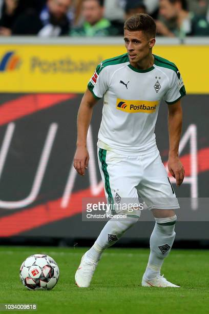 Thorgan Hazard of Moenchengladbach runs with the ball during the Bundesliga match between Borussia Moenchengladbach and FC Schalke 04 at BorussiaPark...
